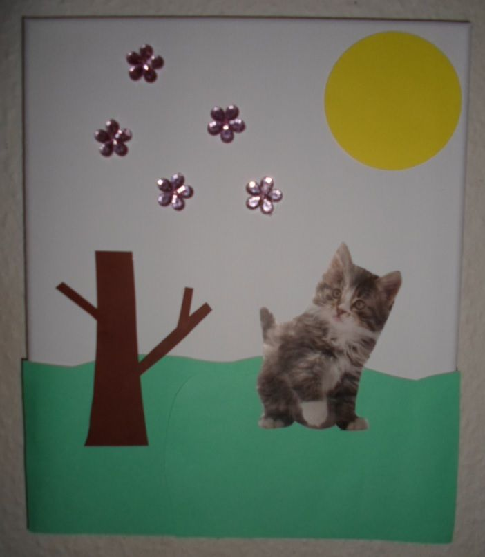 Kitten looking at flowers collage.