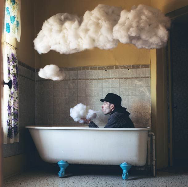 clouds hanging over man in bathtub man dressedin  coat hat, Ambivalence – The surreal photos by Logan Zillmer