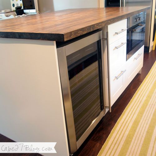 DIY Kitchen Island - base is Ikea cabinets, butcher block from Lumber Liquidators stained with Minwax Dark Walnut