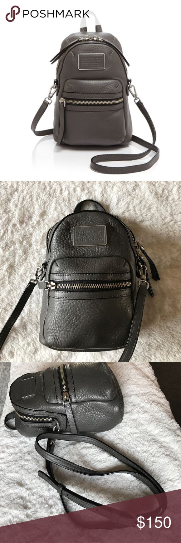 """Marc by Marc Jacobs Domo Biker Crossbody Bag Petite Backpack style. Used only for a short while- great condition. Faded aluminum color with silver hardware. Zip pocket and logo plaque in front. 2-way top zip and lined, 1 pocket interior. Optional, adjustable shoulder strap. Leather cowhide. 8.75"""" H x 6"""" L x 3.5"""" D. 22"""" strap drop. Marc By Marc Jacobs Bags Crossbody Bags"""
