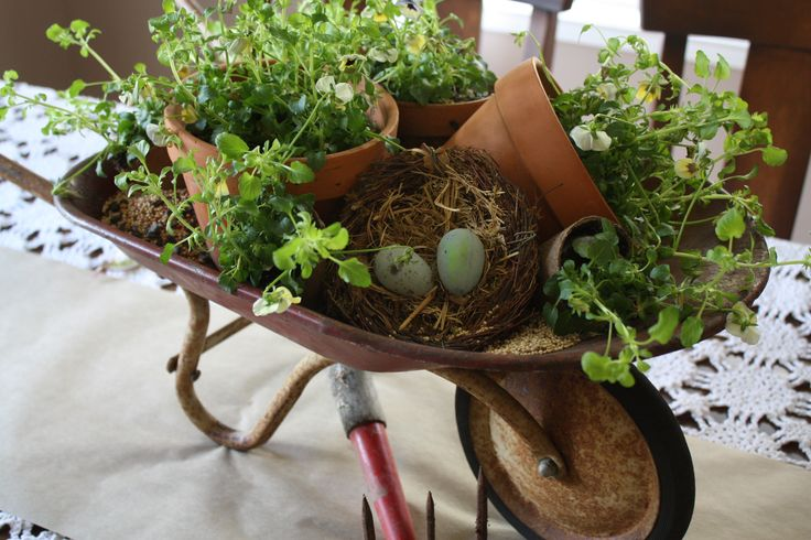 Repurpose a battered old wheelbarrow for a spring centerpiece with pots of herbs and floral supplies - adorable!