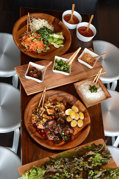 Gorgeous Asian-inspired menu - grilled meats, lettuce cups, sauces and condiemtns - for Lunar New Year or any celebration. These chefs did this spread for their wedding rehearsal dinner.