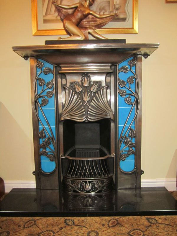Art Deco blue fireplace with ginkgo leaves!!!! GORGEOUS!