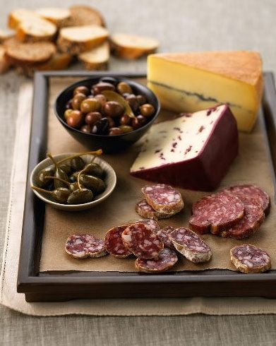 Cheese, olive and meat plate.