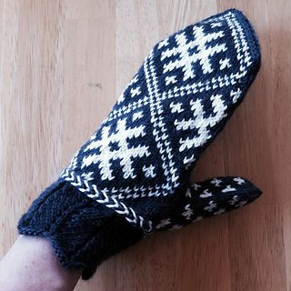 Winter Sun Mittens by Donna Druchunas . knit with lacy cuff, baltic braid trim, and a geometric Lithuanian design that represents the sun and stars