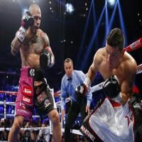 Miguel Cotto vs Sergio Martinez: Miguel Cotto scored four knockdowns and Wins