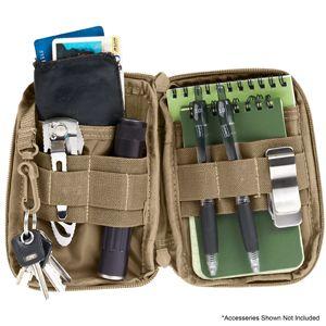 """Mini Pocket Organizer - 24$ Небольшой размер позволит комфортно носить Mini Pocket Organizer в кармане брюк, сумке или куртке. Удобная организация мелочей помогает упорядочить все его содержимое. Возможность крепить органайзер к MOLLE панели удачно дополнит любую сумку или рюкзак, совместимые с этой функцией.   Размеры: 15х10 см  Описание  Очень компактный органайзер, размеры 4"""" x 6"""" x 0.75"""". Помещается в большой карман джинсов или сумки, рюкзака."""