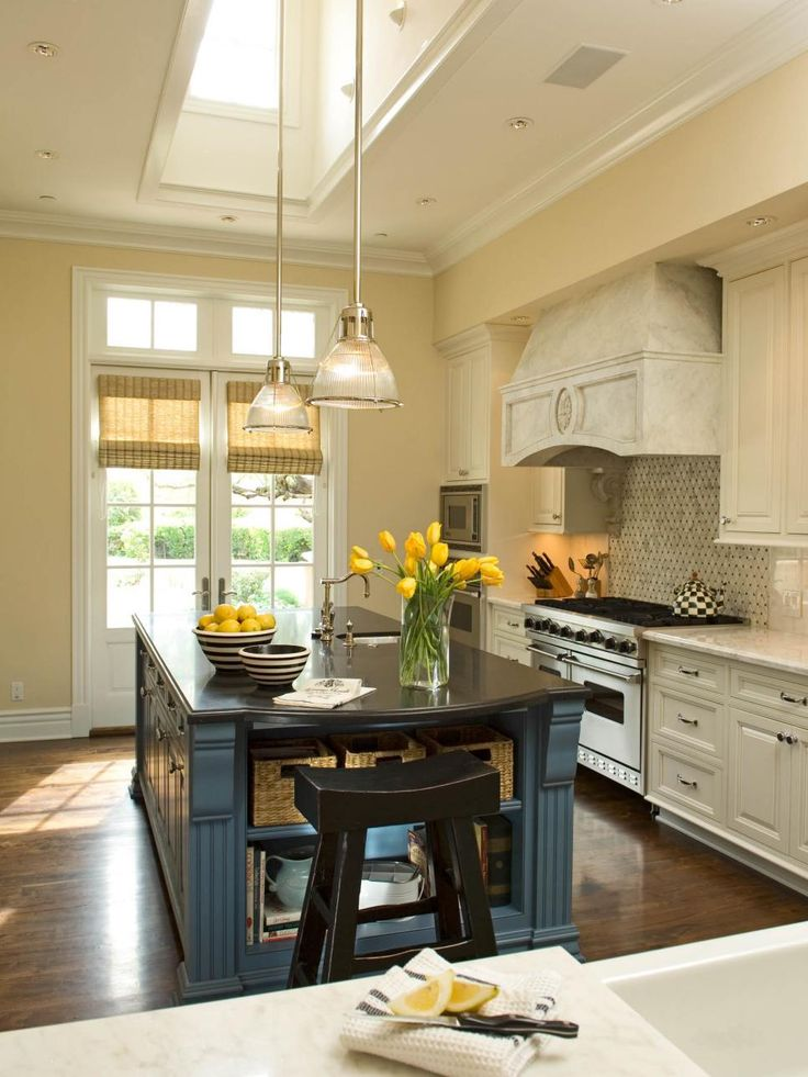 This Warm French Country Kitchen Gets Lots Of Light From Windows And A Skylight As Well