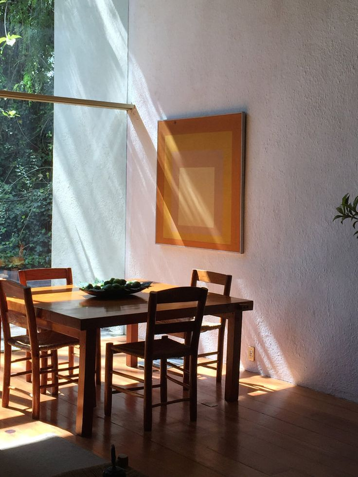"""""""This is in Barragán's living room, which faces the garden. I love the simplicity of the dining table set against the painting by Josef Albers. Both men had a lot in common; they're known for their approaches to composition, obsession with the square and devoting themselves to experiments in color."""""""