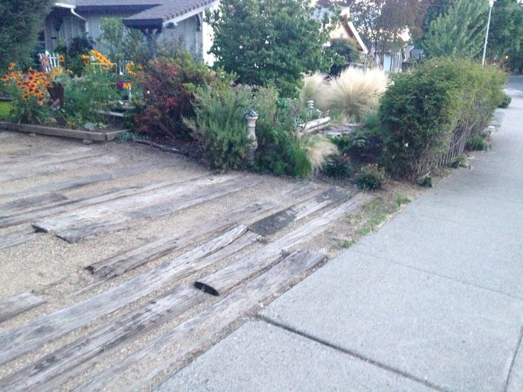 Decomposed granite and wood driveway Strong enough for an