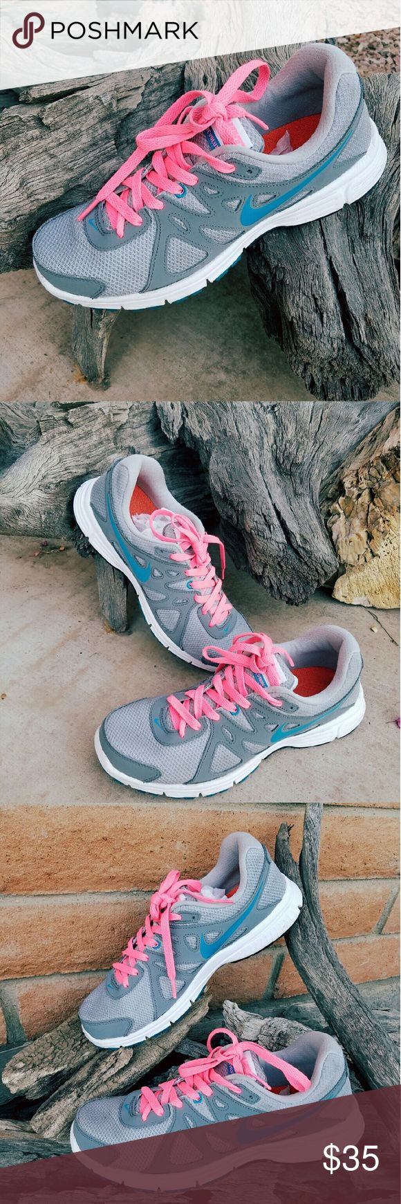 Nike Revolution 2 women In good used condition Nike Revolution 2. Barely used it, pretty taken care. Nike Shoes Athletic Shoes