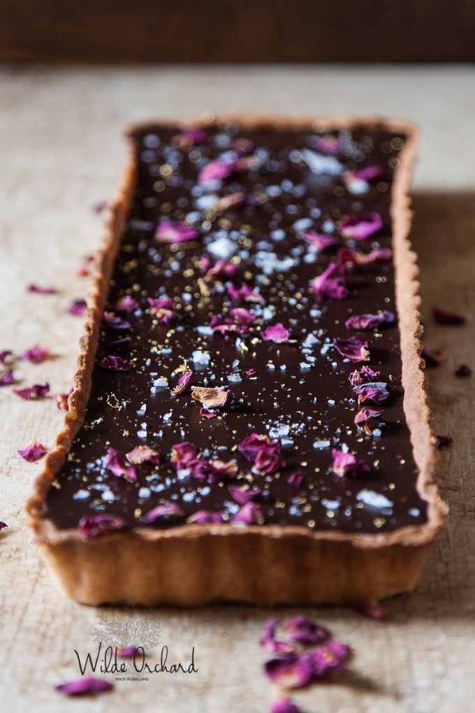 Chocolate Caramel and Rose Tart| The creamiest chocolate ganache with sea salted caramel and rose petals for the pretty factor. Super easy and impressive. | www.wildeorchard.co.uk