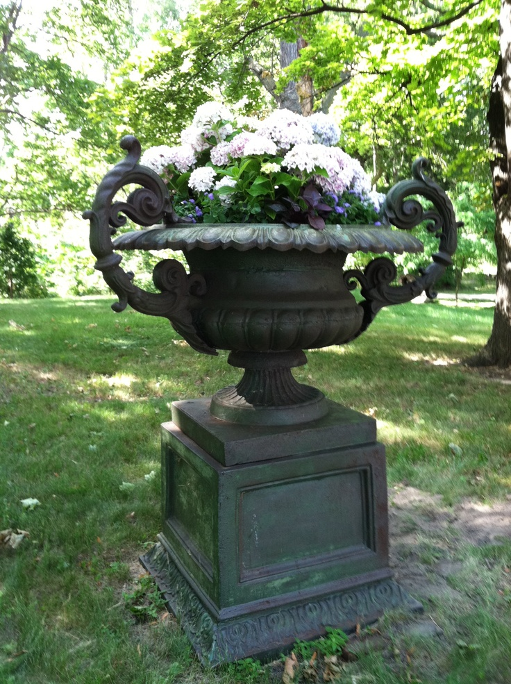 This garden urn was planted with white and pink and blue hydrangeas for last summer's garden tour. So romantic!