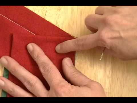 tutorial video for binding unusual angles with a mitered corner. Very clear directions.