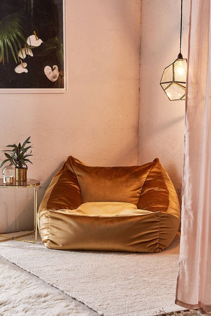 Beautiful interiors; cosy corner with a velvet lounge chair and blush walls.