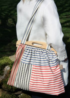 Produced from 100% cotton ticking, these individually designed patchwork bags are fully lined, with wooden handles and longer fabric shoulder straps. They are a great size for numerous different purposes. Made in UK. (Please note bags may vary slightly from picture due to the patchwork design) Approx size 47cm x 36cm.