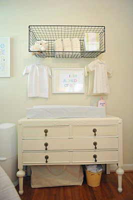 I love the wire basket for storage and a vintage dresser for a changing table...cute