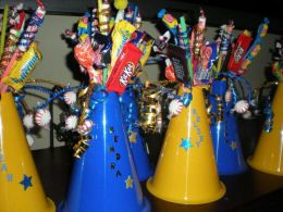 Plastic megaphones were used as the base and the grad's favorite candies, mini chocolate bars and suckers were attached to colorful pipe cleaners and stuck in the megaphones.