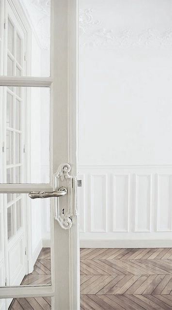 Beautiful herringbone distressed wood floors, French door, white.