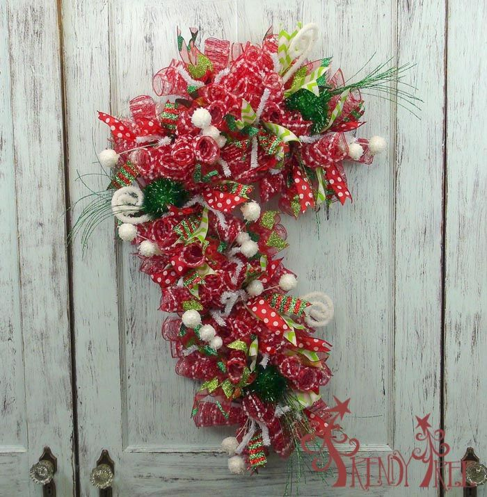 Candy Cane Wreath Tutorial - Trendy Tree Blog -  used a Candy Cane Wreath form, poly mesh, ribbons and RAZ Christmas sprays  - see the post for directions and supplies.