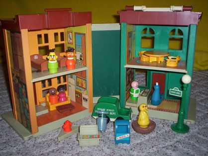 FISHER-PRICE PLAY FAMILY SESAME STREET PLAYSET: Ah, yes… 123 Sesame St, New York, NY.  The very brownstone where Ernie and Bert knew the love that dare not speak its name. I loved the street sign, and the garbage truck, and the little Hooper's Diner booth.  And the crooked sticker that made up Oscar's face.