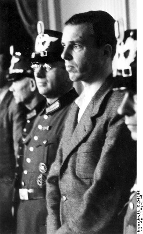 Berthold Schenk Graf von Stauffenberg (1905-1944) was a German aristocrat and lawyer who was a key conspirator in the plot to assassinate Adolf Hitler on July 20, 1944 alongside his younger brother, Colonel Claus Schenk Graf von Stauffenberg. In this image, he is seen during his show trial in the Volksgerichtshof on August 10, 1944. He was found guilty and executed later that same day.