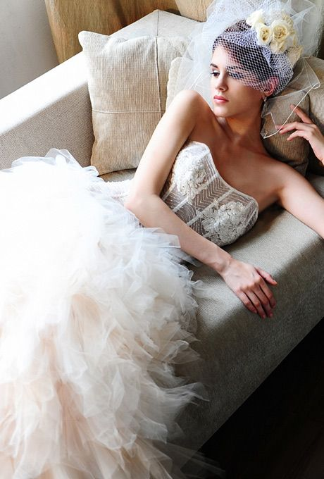 Brides: Saison Blanche Couture. Strapless ball gown featuring a sheer silk organza beaded bodice in Swarovski crystals, handkerchief folded soft net and silk organza skirt.��More Details From Saison Blanche Couture