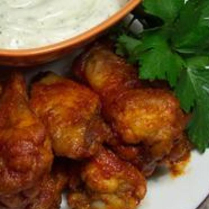 I tried many different Buffalo wing recipes but I stopped searching when I found this one! Its perfect! And they're baked, not fried! So its a little less fattening! This is a mild version, but you can make it as spicy as you like by just adding more cayenne pepper and less honey. I added my photo.