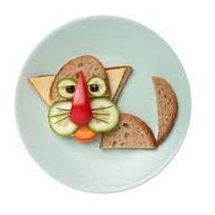 Photo: Cat made of bread on olive plate