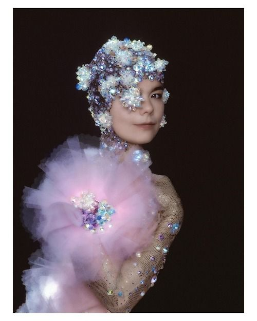 bjork...quirky girl!  Love the powdery feel of her look.