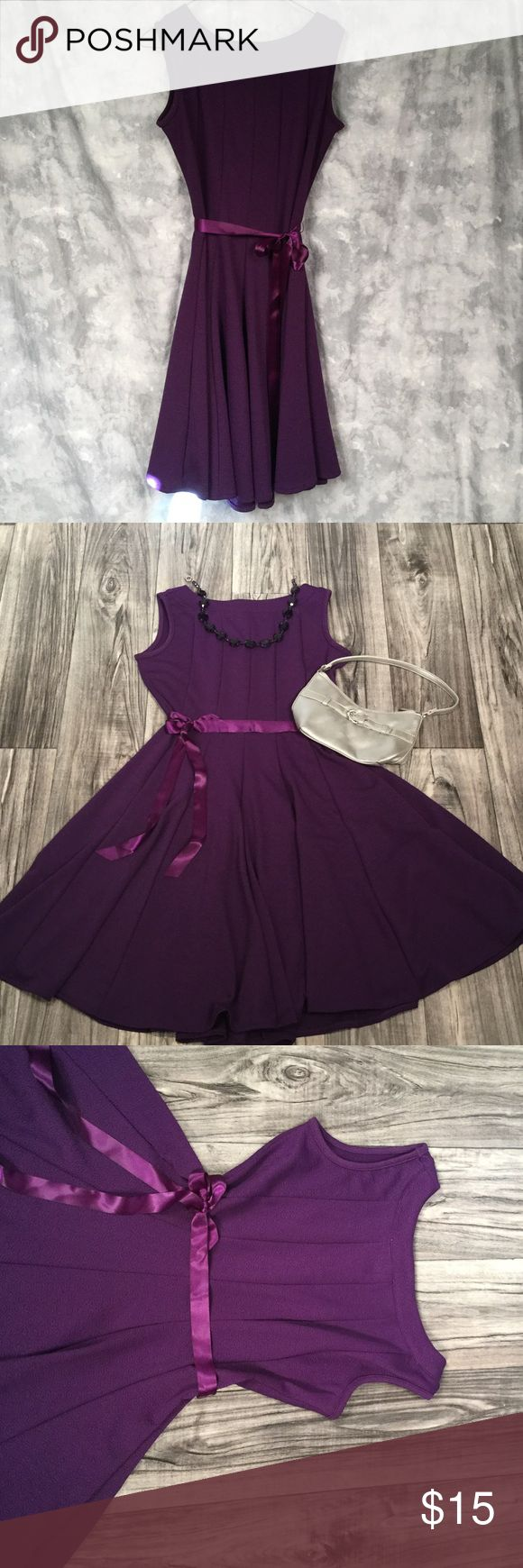 Totally Purple Petite Dress Petite Medium Dress. Like NEW, worn once. 94% polyester 9% spandex. Fabric has a textured design. Includes Ribbon Sash. Great for traveling. Very wrinkle resistant. HAANI Dresses