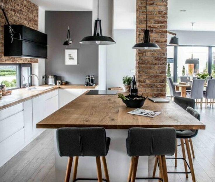 Fenêtres panoramiques Table en bois de bonne taille  Mur pierre Association noir/bois/pierre
