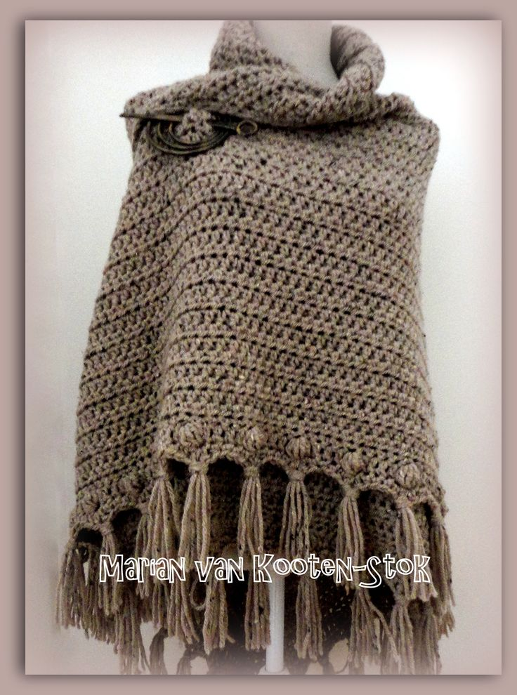 Here you can find the diagram of this shawl, http://www.pinterest.com/pin/126734176989549328/ For the edge you could use DROPS Crochet Tutorial: How to crochet bobble stitch crochet http://www.pinterest.com/pin/126734176989609618/