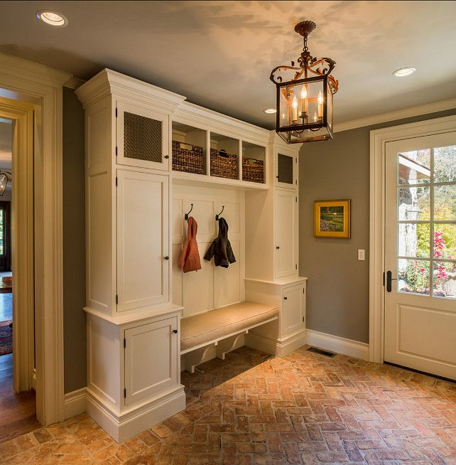 Mudroom. This Mudroom is just Perfect! Great Flooing and Storage space! #Mudroom #InteriorDesign Cabinet & Trim Paint Color: Benjamin Moore ...