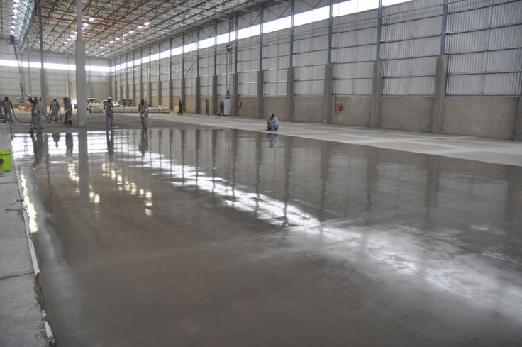 Industrial self-levelling screed applied onto new failed warehouse floor
