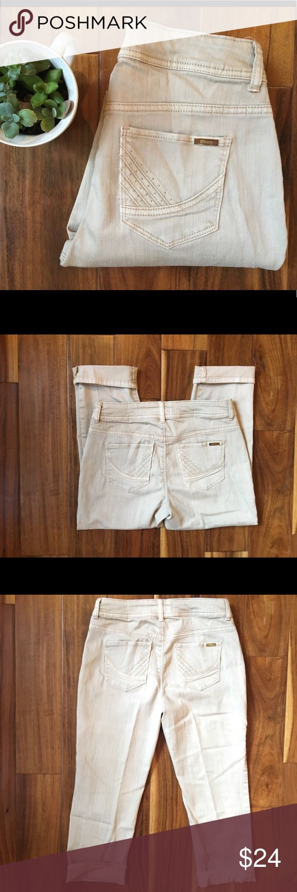 Chicos Jeans - Cream Crop Leg These are mid calf length and stretchy without stretching too much! Great quality and never before worn. These pants were my mother's and she normally wears a 28 or 6/8 in jeans so this 00 size is deceptive! Very flattering! Chico's Jeans Ankle & Cropped