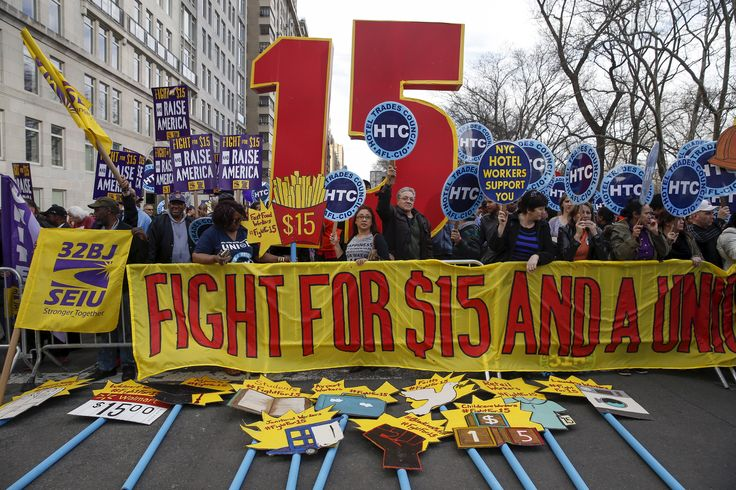 Three years since a small group of fast-food workers began protesting in demand of higher pay and better conditions, a minimum wage of $15 an hour is becoming a reality for many across the country. Jeffrey Brown gets two perspectives from Michael Strain of the American Enterprise Institute and former Secretary of Labor Robert Reich.