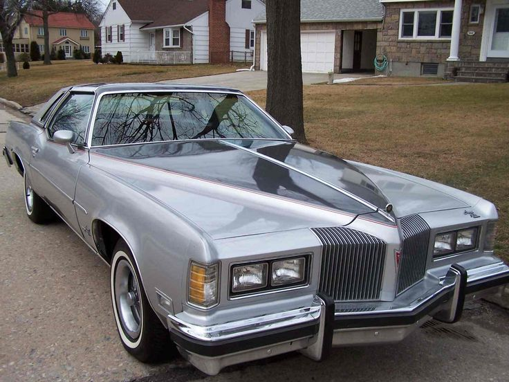 1976 Pontiac Grand Prix:  Mary Nell had a silver 1976 Grand Prix with every possible options, I think...