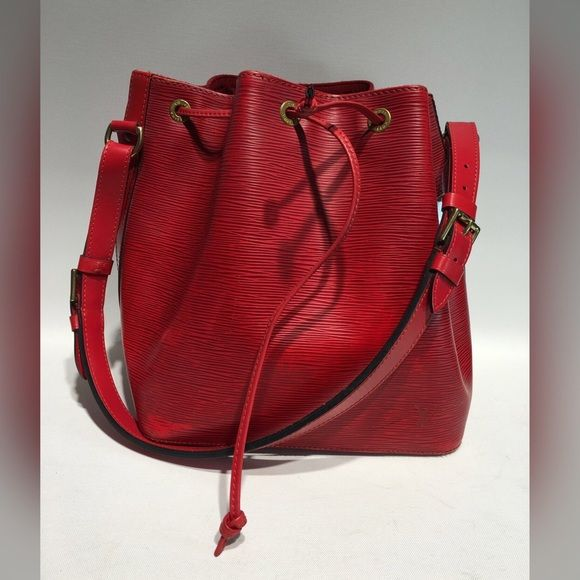 Authentic Louis Vuitton Epi Petite Noe This is a gently loved Louis Vuitton Noe in gorgeous red Epi leather, a perfect bucket bag. There are some minor abrasions and gentle wear to the leather, as pictured. Authenticity guaranteed! Please, no trades. Louis Vuitton Bags Shoulder Bags