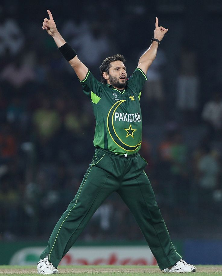 Shahid Afridi, a famous cricket player ( cricketer) from PAKISTAN.  he is well known for his faster run scoring and also lethal - wicket taking bowling . this action of his is his signature style. People roar out loud when he does this after scalping a wicket through his own bowling or getting a player RUN-OUT  by his feilding ...