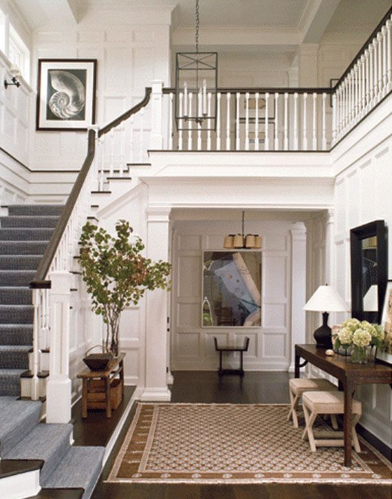 This large front hall with open stairs beautiful woodwork Design ideas for hallways and stairs