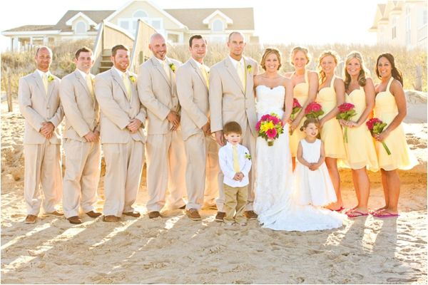 light yellow bridesmaid dresses, pink gerbera daisy bouquets, classic men's beach attire, beige suits, light yellow silk vests and ties, sperry top siders, stylish beach bridal party, adorable ring bearer and flower girl, yellow and pink beach wedding, Macon Photography