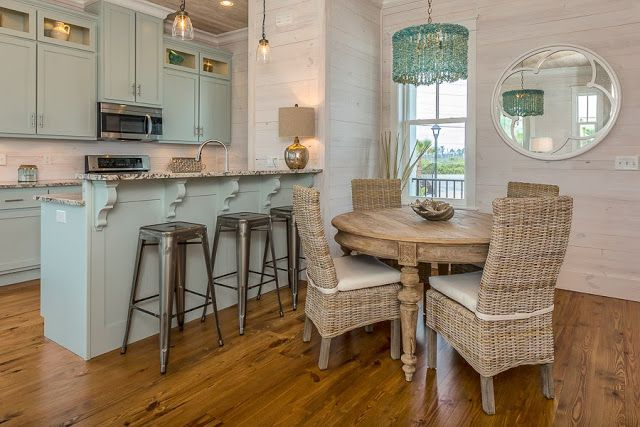 Love the blue grey cabinets... the wicker... the aged teak looking table... it works.