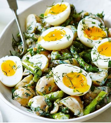 New potatoes, asparagus, soft boiled eggs and a buttermilk, parsley and dill dressing make up this impressive potato salad.