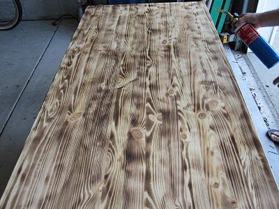 Unfinished pine Ikea table top, you can use a blow torch to burn the wood, sand and stain and you have an expensive looking piece of wood!