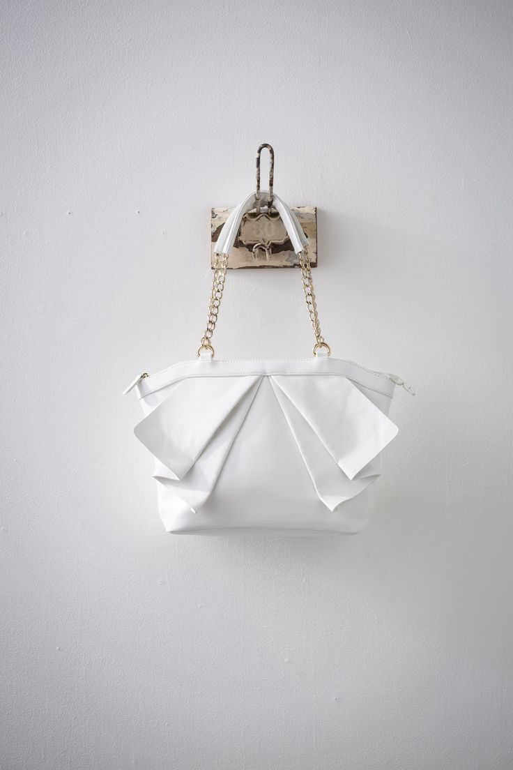 Eshe (White) available at #zierashoes http://zierashoes.com/page/handbags