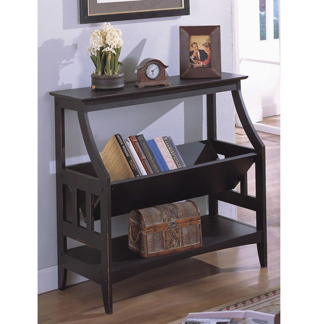 This solid wood bookshelf is a perfect accessory for any room. The smooth tabletop is ideal for a nice lamp and knickknacks, and the central V-shaped shelf makes it easy to display your favorite books. The black finish matches any style.
