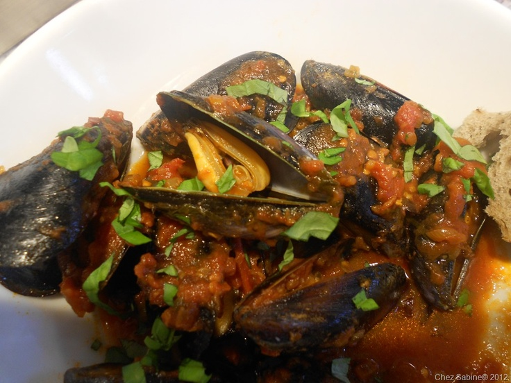 Mussles with a spicy puttanesca-inspired sauce. So easy.