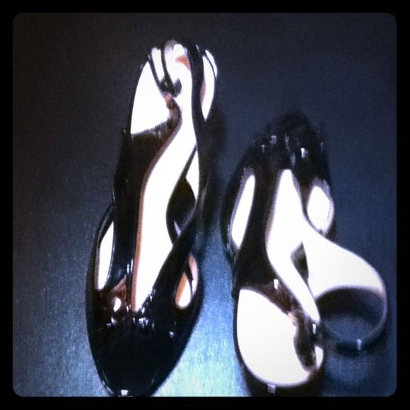 """Guess black patent high heel shoes. 4.5"""" heel. Worn on the runway only. Some scratches on sole.  Perfect for spring/summer.  Gold accent. Guess Shoes"""