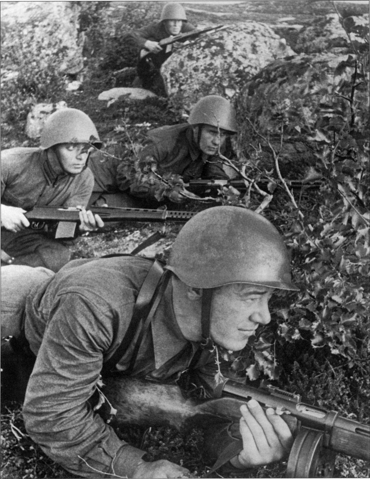 A Russian platoon leader watches enemy positions, Northern Front, summer 1942. The soldier in the forefront is armed with a PPSh full auto assault rifle , the others with the Tokarev SVT 40( or 38) semiauto rifle.